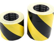 Cable cover black and yellow tunnel tape
